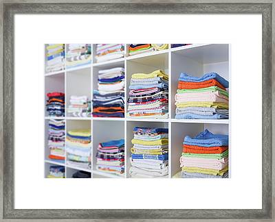Folded Towels On Shelves Framed Print