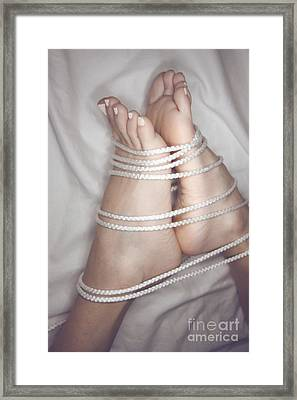 Foot Bound Framed Print by Tos
