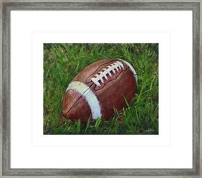 Football On Field Framed Print by Craig Tinder
