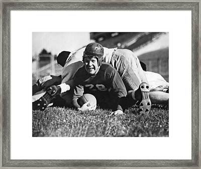 Football Player Gets Tackled Framed Print