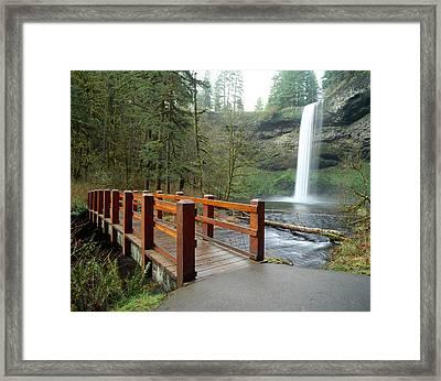 Footbridge Across A River Framed Print