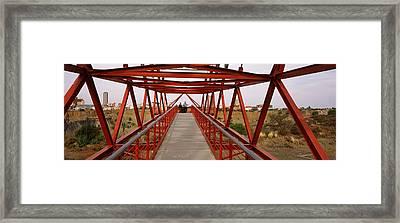 Footbridge With A City Framed Print