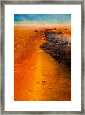 Footprints And Reflections Framed Print by Shawn Brannon