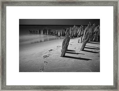 Footprints In The Sand Among The Pilings Framed Print by Randall Nyhof