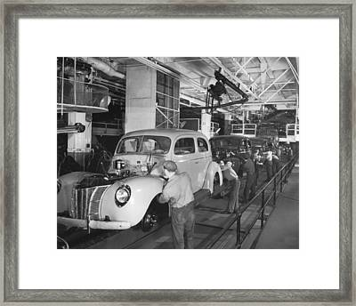 Ford Assembly Line Framed Print by Underwood Archives