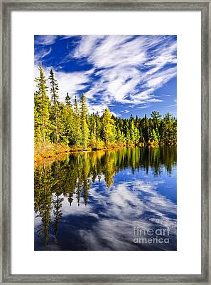 Forest And Sky Reflecting In Lake Framed Print