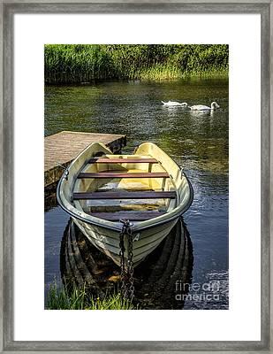 Forgotten Boat Framed Print by Adrian Evans