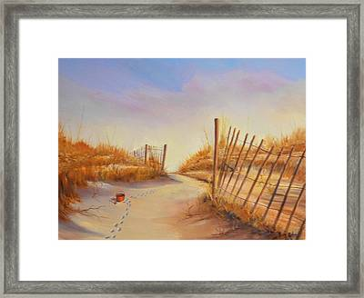 Forgotten Toy In The Sand Framed Print by Rich Kuhn