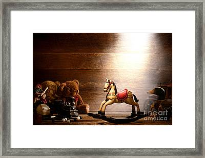 Forgotten Toys Framed Print by Olivier Le Queinec