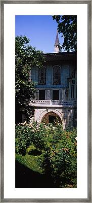 Formal Garden In Front Of A Building Framed Print