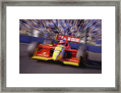 Formula Racing Car At Speed Framed Print by Don Hammond