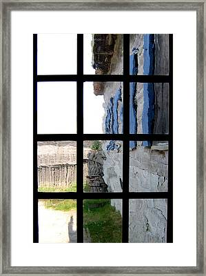 Framed Print featuring the photograph Fort Mackinac Through An Old Window by Mary Bedy