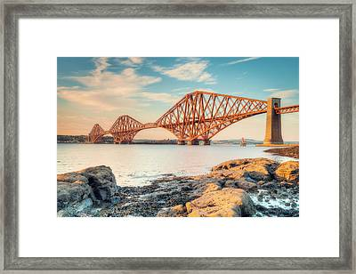 Forth Bridge At Sunset Framed Print by Ray Devlin