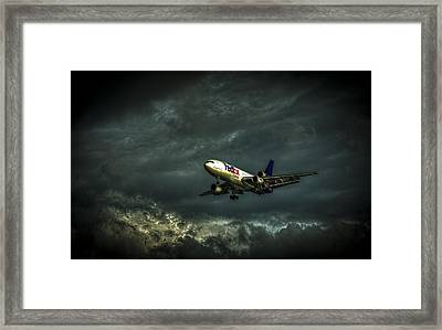 Foul Weather Fedex Framed Print by Marvin Spates