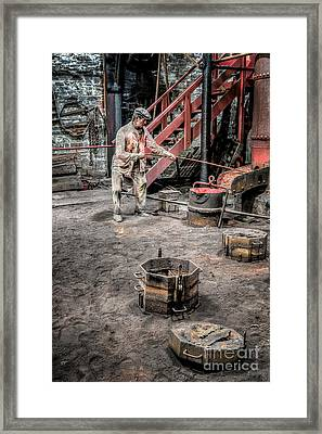 Foundry Worker Framed Print by Adrian Evans
