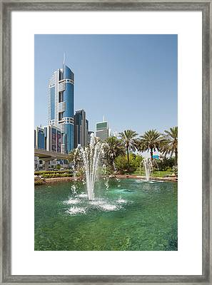 Fountain And Downtown Skyline Of Dubai Framed Print by Michael Defreitas