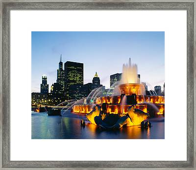 Fountain In A City Lit Up At Night Framed Print by Panoramic Images