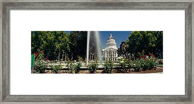 Fountain In A Garden In Front Framed Print by Panoramic Images