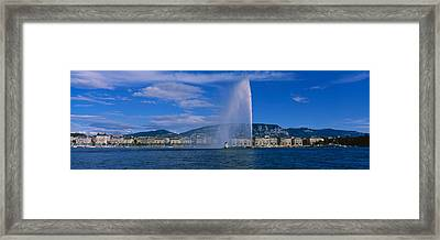 Fountain In Front Of Buildings, Jet Framed Print