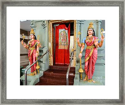Four-armed Deities Guard The Inner Sanctum Of A Hindu Temple Framed Print by David Hill