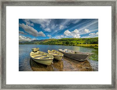 Four Boats Framed Print by Adrian Evans