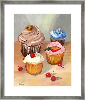 Four Cupcakes Framed Print by Susan Thomas