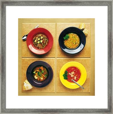 Four Dishes Of Different Food Framed Print by Ron Nickel