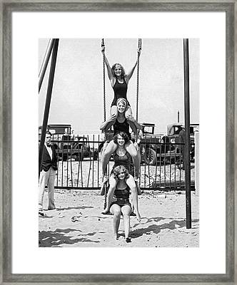 Four Girls On A Swing Set Framed Print by Underwood Archives