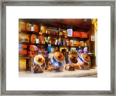 Four Glass Candy Jars Framed Print by Susan Savad