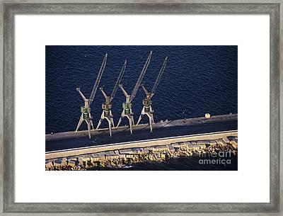Four Harbour Cranes On Dike Framed Print by Sami Sarkis