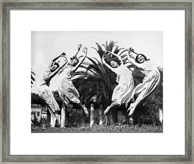 Four Leaping Grecian Dancers Framed Print by Underwood Archives