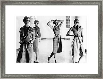 Four Models Standing In A Hallway Framed Print by Deborah Turbeville