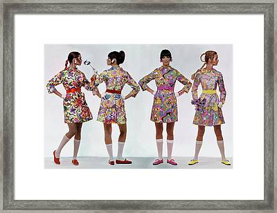 Four Models Wearing Colorful Print Dresses Framed Print by Gianni Penati