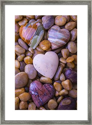 Four Stone Hearts Framed Print by Garry Gay