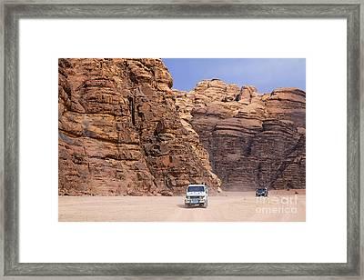 Four Wheel Drive Vehicles At Wadi Rum Jordan Framed Print by Robert Preston