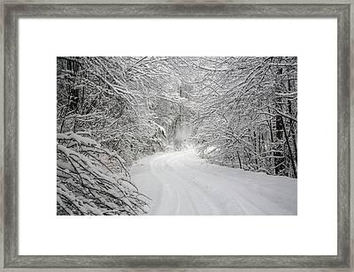 Four Wheel Winter Framed Print by John Haldane