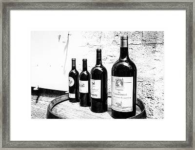 Four Wine Bottles Framed Print by Georgia Fowler