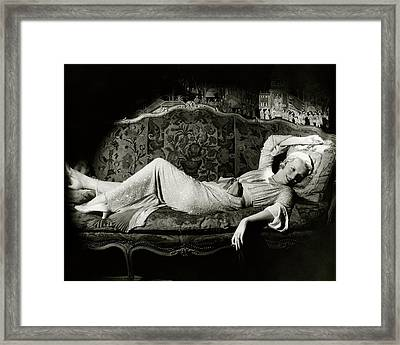 Frances Willams Lying On A Couch Framed Print by Cecil Beaton