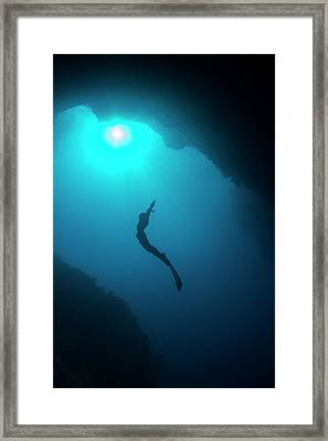 Free Diver In Mouth Of Cave Framed Print