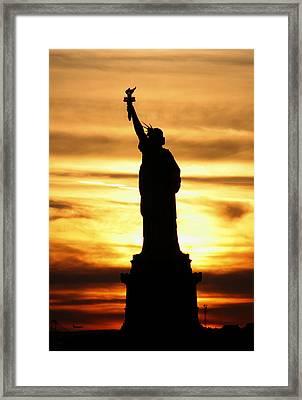 Statue Of Liberty Silhouette Framed Print by Bob Slitzan