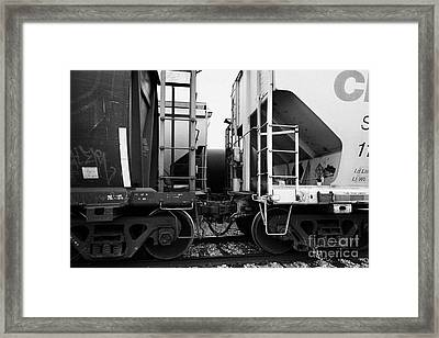 freight grain trucks coupling on canadian pacific railway Saskatchewan Canada Framed Print by Joe Fox