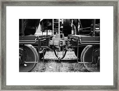 freight grain trucks coupling on former canadian pacific railway Saskatchewan Canada Framed Print by Joe Fox