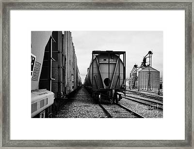 freight grain trucks on canadian pacific railway at assiniboia depot Saskatchewan Canada Framed Print by Joe Fox