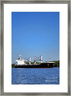 Freighter On River Framed Print by Olivier Le Queinec