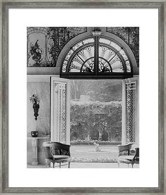French Doors Leading To A Garden Framed Print by Wynn Richards
