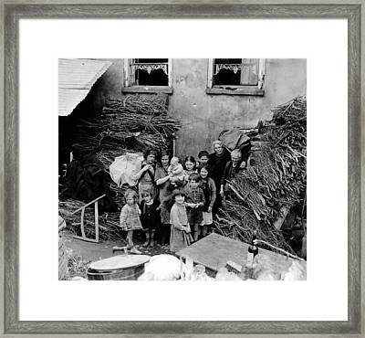French Family Outside Their Home Framed Print by Everett