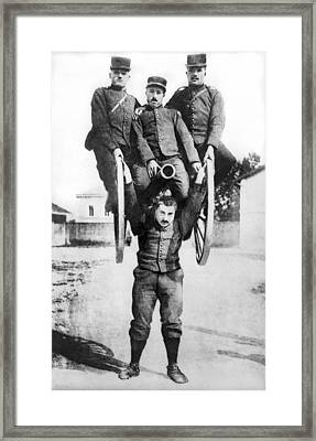 French Strongman Lifts Cannon Framed Print