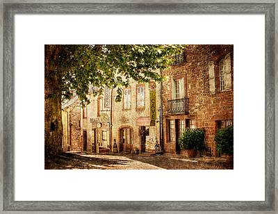 Framed Print featuring the photograph French Village Street / Meyssac by Barry O Carroll