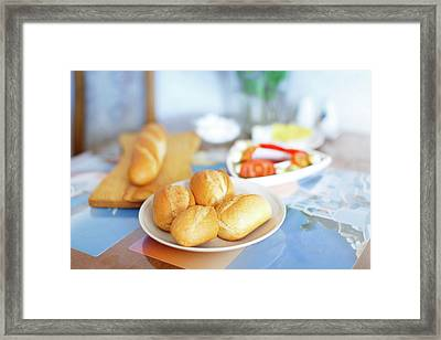 Fresh Bread Rolls On The Table Framed Print by Wladimir Bulgar