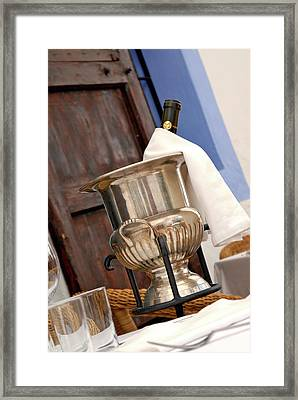 Fresh Champagne Bottle On A Table Framed Print by Nano Calvo